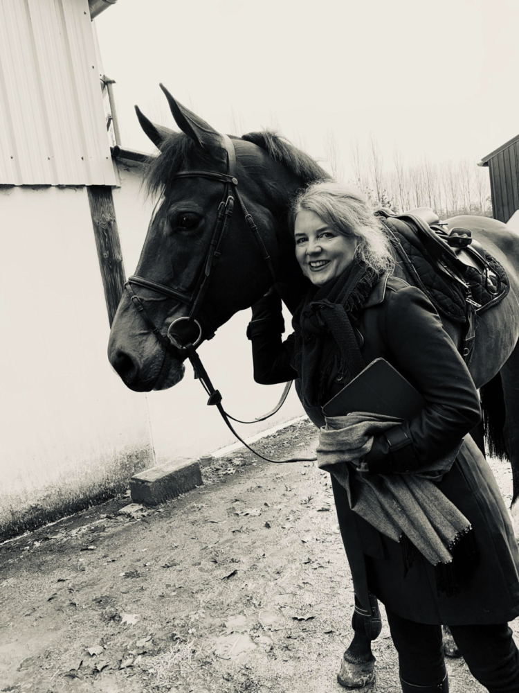 Owner Renée keeping warm while in France